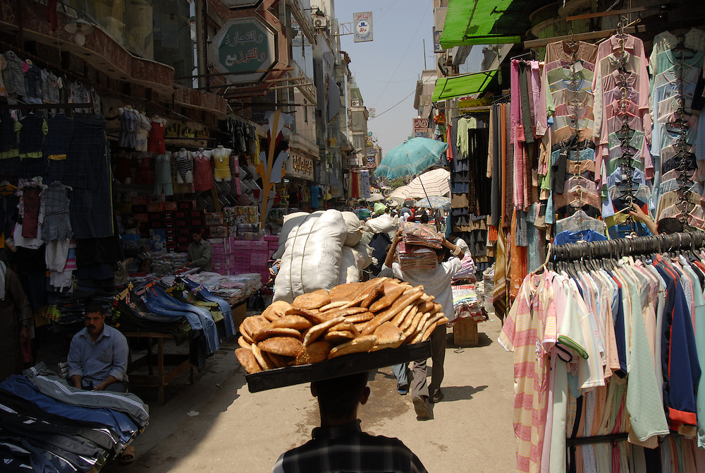 Boy carries bread on his head in Khan el-Khalili market in Cairo, Egypt.