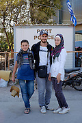 Faris (24 centre) with his wife Nour (18,5 right) and his brother Mohamed (12) are from Aleppo in Syria. He married his wife just before they left Syria where he was a Telecommunications engineer and she had just finished a medical high school. They were travelling together with their parents who decided to stay in Turkey because they didn&rsquo;t want to do the difficult trip to Europe. His father had a bus company that closed down during the war. He and his wife want to go to Norway because he heard that this country is the best when it comes to Human Rights. He thinks that is more important than money. He wants to continue his studies there and get a Phd. She wants to study Architecture.<br /> The port of Mytilene where many refugees stay while they apply for a permit to stay in Greece or while they are waiting to board the ferry to Athens.