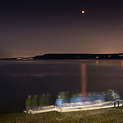 Kayakers take out of the water after watching the full moon total eclipse on Sequim Bay, WA. It was a perigee moon (when the moon is closest to Earth) and a total lunar eclipse which coincided for a few hours, resulting in a total eclipse of the largest full moon of the year. Although these astronomical events can happen separately several times a year, this combination has only happened five times since 1900, with the last coming in 1982. If you missed this one, you won't get another chance until 2033!