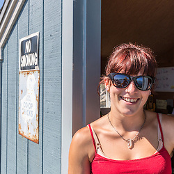 Vinalhaven Fishermen's Co-op employee Karen Krager on the co-op wharf in Vinalhaven, Maine.