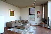 Living room in modern apartment on Sarphatistraat, Amsterdam