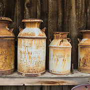 Rusting milk jugs at the Eastern California Museum, 155 N. Grant Street, Independence, California, 93526, USA. The Museum was founded in 1928 and has been operated by the County of Inyo since 1968. The mission of the Museum is to collect, preserve, and interpret objects, photos and information related to the cultural and natural history of Inyo County and the Eastern Sierra, from Death Valley to Mono Lake.