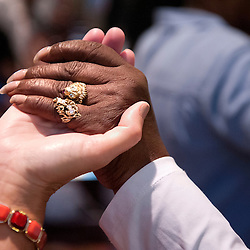 2 AUG. 2015 -- ST. LOUIS -- Worshipers join hands during Mass Mob III at Sts. Teresa and Bridget Catholic Parish in St. Louis Sunday, Aug. 2, 2015. The event brings Catholics from across the Archdiocese of St. Louis to worship at historic, urban parishes.<br /> <br /> Photo by Sid Hastings.