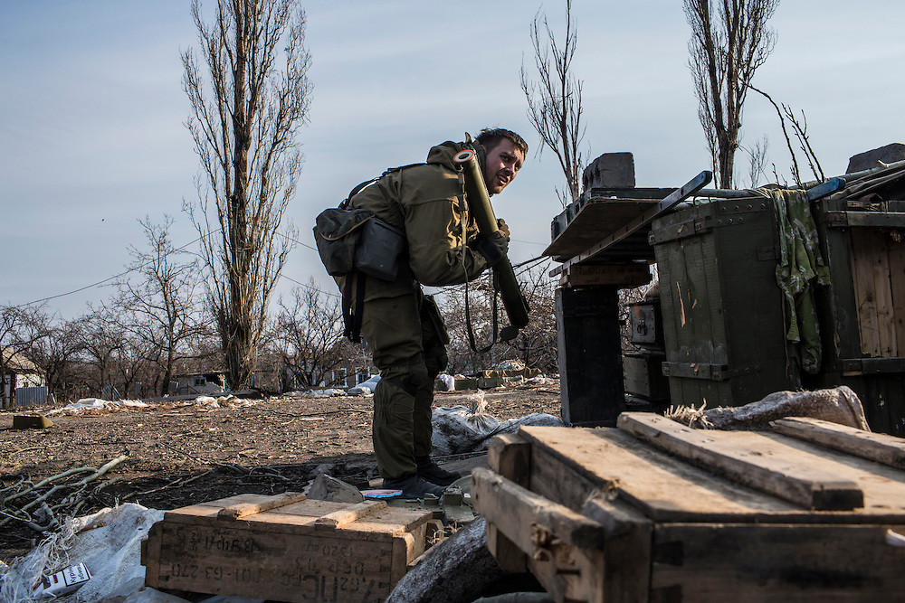 PISKY, UKRAINE - MARCH 20, 2015: A fighter for the Dnipro-1 battalion, a pro-Ukrainian militia, prepares to fire a shoulder-launched anti-tank rocket toward pro-Russian rebel positions in Pisky, Ukraine. CREDIT: Brendan Hoffman for The New York Times