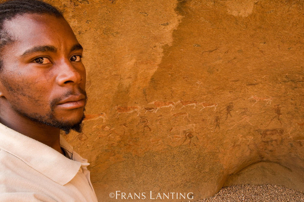 Guide at 'White Lady' rock art panel, Brandberg, Tsiseb Conservancy, Damaraland, Namibia