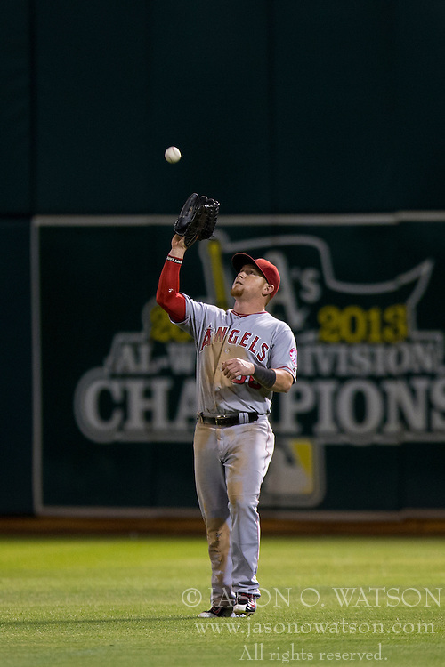 OAKLAND, CA - SEPTEMBER 23:  Kole Calhoun #56 of the Los Angeles Angels of Anaheim catches a fly ball against the Oakland Athletics during the eighth inning at O.co Coliseum on September 23, 2014 in Oakland, California. The Los Angeles Angels of Anaheim defeated the Oakland Athletics 2-0.  (Photo by Jason O. Watson/Getty Images) *** Local Caption *** Kole Calhoun
