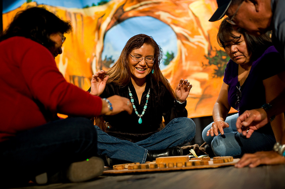 011310        Brian Leddy.Genevieve Hardy plays teh Navajo stick game at the Navajo Nation Museum on Wednesday morning. While many people are unfamiliar with the game, museum employee Robert Johnson says it is similar to the stick game and is only played in the winter.