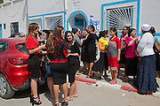 Tunisian Jewish women celebrate following a circumcision  ceremony on a newborn male baby outside a  home in the  Hara Kebira neighborhood  in Djerba on May 25,2016. (Photo by Heidi Levine).