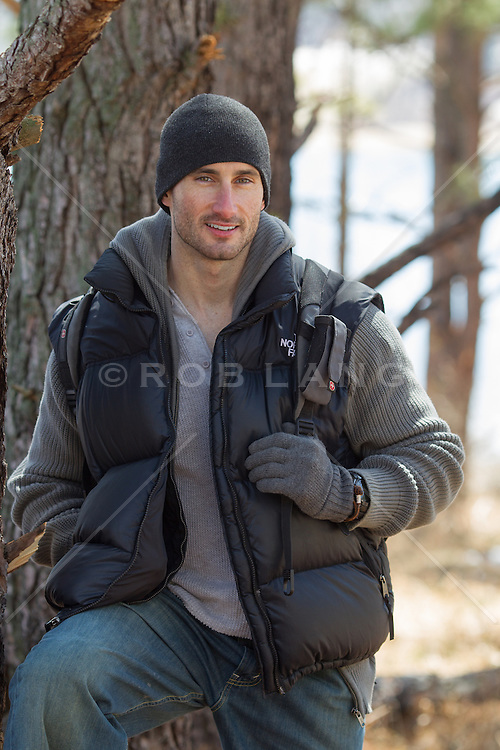 good looking rugged man outdoors in the woods during the