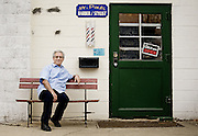 Paul Saltarello, owner of Mr. Paul's Barber Shop in Owasco, raised money locally and traveled to Italy to aid a village struck by an earthquake.<br /> <br /> Sam Tenney / The Citizen