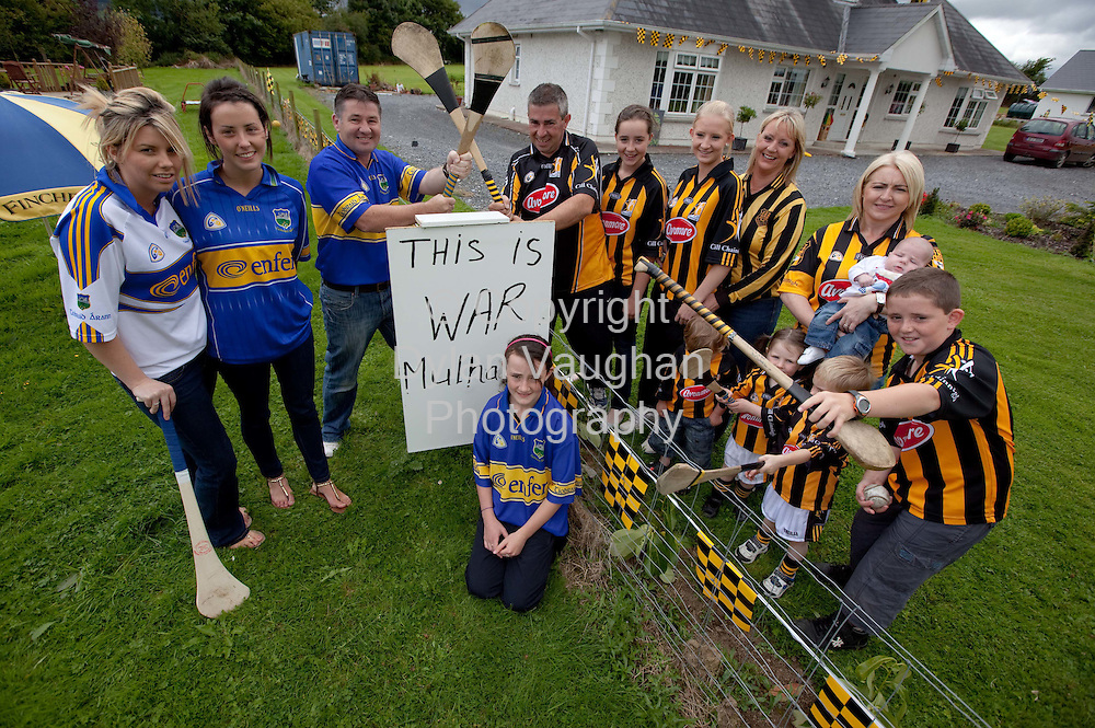 22/8/2009.Pictured at the the fence between two house at Poulnacapple which divides Tipperary and Kilkenny was on the Tipperary side from left Eimear Norton, Roisin Norton, Jackie Bolger and Niamh Burke. .Back from left on the Kilkenny side was Martin Mulhall, Kelsey Mulhall, Saoirse Mulhall, Bernadette Mulhall, Tina Bolger, baby Aaron Fitzpatrick and Marty Mulhall..Front from left Zach Dunne,Ria Fitpatrick and James Barry..Picture Dylan Vaughan.