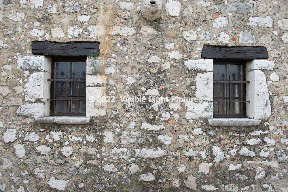 Two windows on a building in St. Paul de-Vence