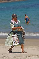 A vendor sales trinkets at the beach in Puerto Vallarta Mexico.