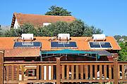 Israel, Upper Galilee, Solar water heaters on a roof