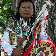 Portrail Carlos Eagle Feather, Mayan and Apache, Native American, dressed in Pow Wow Regalia.  <br /> <br /> Carlos in is a Thunderbird pow wow dancer at the Drums along the Hudson Pow Wow.<br /> Examples of ethnic pride, heritage, celebration, and traditional folk art crafts. <br /> <br /> Release # 2689