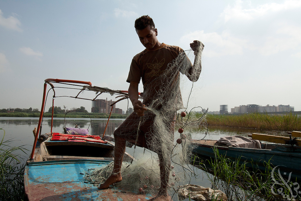 Egyptian fisherman Abdel Hamid Mahrouz checks his fishing nets along the banks of the Nile river October 27, 2011 in the village of Warwara, about 50 kilometers north of the capital, Cairo. Fisherman like Mahrouz say that since the recent revolution, the Egyptian government has stopped stocking the Nile with fingerlings, and their livelihoods are now being effected.  (Photo by Scott Nelson)