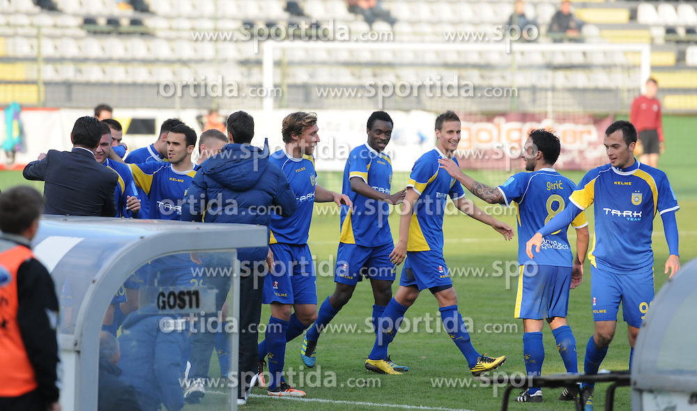 Players of Domzale celebrate during football match between NK Mura 05 and Domzale in 18th Round of PrvaLiga NZS 2012/13 on November 11, 2012 in Fazanerija, Murska Sobota, Slovenia. (Photo By Ales Cipot / Sportida)