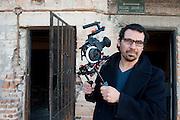 Documentary filmmaker Angel Estrada Soto in his childhood neighborhood in Ciudad Juarez, Mexico. ..LA FRONTERA: Artists along the US Mexican Border.© Stefan Falke.http://www.stefanfalke.com/