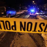 Boston police tape blocks off the scene of a triple shooting.  Photo by Matthew Healey