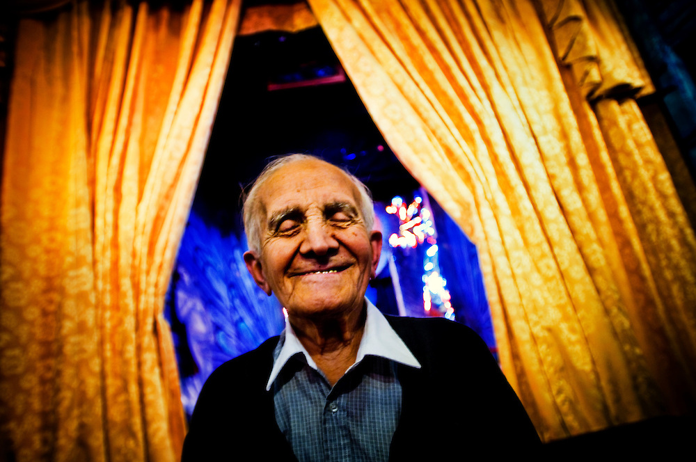 Amato Opera <br /> <br /> Tony Amato in his opera house.<br /> <br /> The Amato Opera company was founded by husband and wife Tony and Sally Amato in 1948. <br /> <br /> The opera house is located on The Bowery, in New York's East Village,  next door to where the legendary punk rock club CBGB used to be.<br /> <br /> While Tony acted as artistic director, selecting the productions, auditioning and casting, rehearsing and training the cast and conducting most of the performances, his wife Sally functioned as seamstress, light board operator, cook, box office manager, publicist, business manager, and, as Serafina Bellantoni, singer for the company until her death in 2000.<br /> <br /> Today Tony at the age of 88 is still running the company like he promised his wife he would, and the Amato Opera maintains its goals of providing opera at a reasonable price and giving promising singers stage experience in full-lenght productions.<br /> <br /> Photographer: Chris Maluszynski /MOMENT
