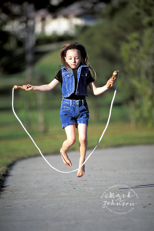Australia, Qld., little girl jumping rope