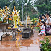 A Laotian family offer prayers at Pha That Luang. The stupa is thought to contain a piece of the breast bone of Loard Buddha.