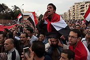 Egyptian anti-government protesters chant anti-Hosni Mubarak slogans as they demonstrate outside the heavily guarded Orouba Presidential Palace February 11, 2011 in the Heliopolis district of Cairo, Egypt. Protesters marched Friday on a number of public buildings including the palace in an effort to spread their ongoing protests that are now in their 18th day. .(Photo by Scott Nelson)