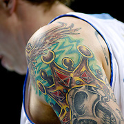 """SHOT 5/3/09 2:17:18 PM - Detail of some of the tattoos that adorn the arm of the Denver Nuggets' Chris Andersen (aka the """"Birdman"""") as he lines up in the lane for a foul shot against the Dallas Mavericks during their NBA Western Conference Semifinals Game 1 at the Pepsi Center in Denver, Co. on Sunday May 3, 2009. The Nuggets won the first game of the series 109-95..(Photo by Marc Piscotty / © 2009)"""