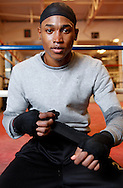 Fighter Wellington Arias Romero (22) sits for a portrait at the Newburgh Boxing Club in Newburgh, NY on Tuesday, October 22, 2013. Originally from the Dominican Republic, and a member of their national team that competed in last year's Olympics in London, Romero is turing pro and fighting on the Bernard Hopkins undercard in Atlantic City, NJ on Saturday.