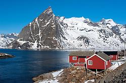 Traditional red wooden Rorbu fishermen`s huts in village of Hamnoy on Moskenesoya Island in Lofoten Islands in Norway