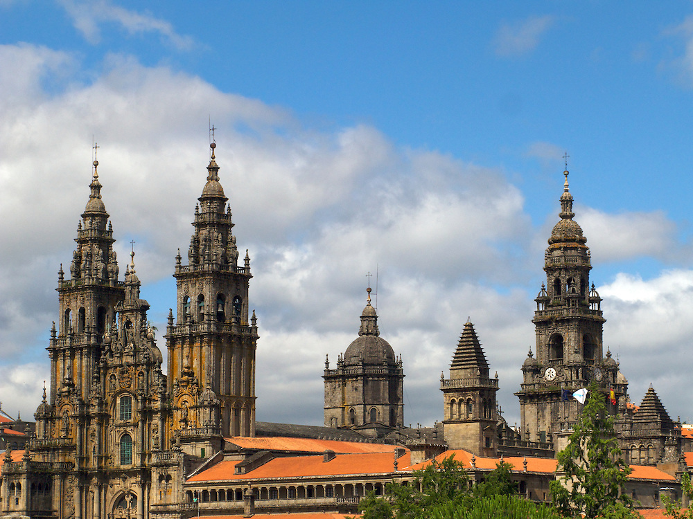 From a park near the city of Santiago de Compostela a magnificent view of the skyline could be found. The spires of the Cathedral rose into the afternoon sky.