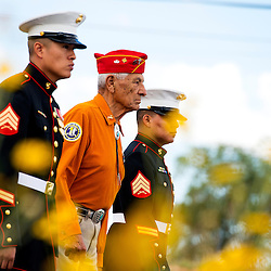 081413        Brian Leddy<br /> Roy Hawthorne is flanked by two young Marines during the annual Navajo Code Talker Day parade in Window Rock Wednesday. The annual Navajo Code Talkers Day event drew hundreds to honor the military veterans that helped win World War II.