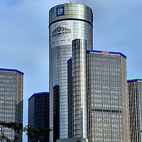 Renaissance Center and General Motors Headquarters in Detroit, Michigan<br /> In 1970, Henry Ford II had a dream to renew downtown Detroit. He formed a private company to begin building what are now seven glass skyscrapers along the International Riverfront called the Renaissance Center. The five-and-a-half million square feet are home to General Motors headquarters and the 73 story, 1,300 rooms Detroit Marriott.