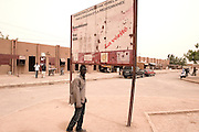 "A warning sign from the European Community in Agadez' bus station about illegal migrants :  "" illegal immigration to Europe through Sahara and mediterranean see, Bantitism, Agression, Rape, Aids, the Truth."""