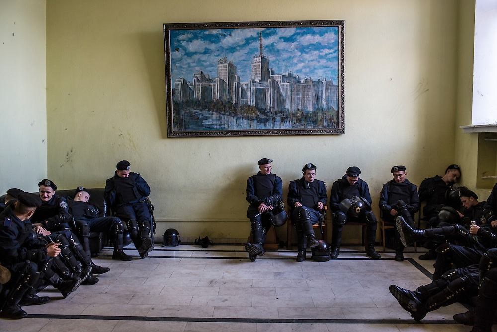 KHARKIV, UKRAINE - APRIL 24: Police officers rest inside the regional administration building as people protest outside on April 24, 2014 in Kharkiv, Ukraine. The legislative body for the Kharkiv region, which was holding a session, was urged by pro-Russian protesters outside to schedule a referendum on greater autonomy from the central government in Kiev. (Photo by Brendan Hoffman/Getty Images) *** Local Caption ***