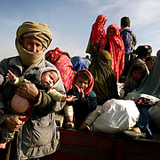 Internally displaced persons prepare to relocate as U.S. planes and special forces begin an assault in northern Afghanistan in October of 2001, pushing the Taliban into the town of Kunduz. Photojournalist Joshua Trujillo traveled there for Hearst Newspapers in October of 2001 to cover the U.S. response to the terror attacks on the United States. These photos are being shared 10 years after the beginning of the U.S. response.