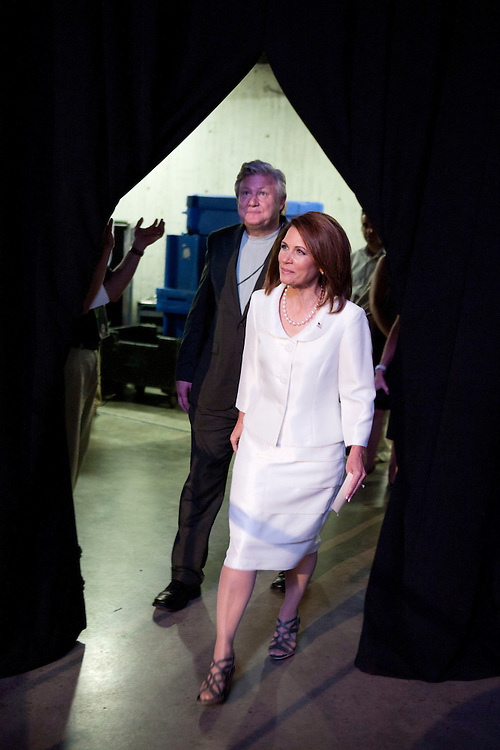 Republican presidential hopeful Michele Bachmann and her husband Marcus Bachmann walk out to the stage at the Iowa Republican Straw Poll on Saturday, August 13, 2011 in Ames, IA.