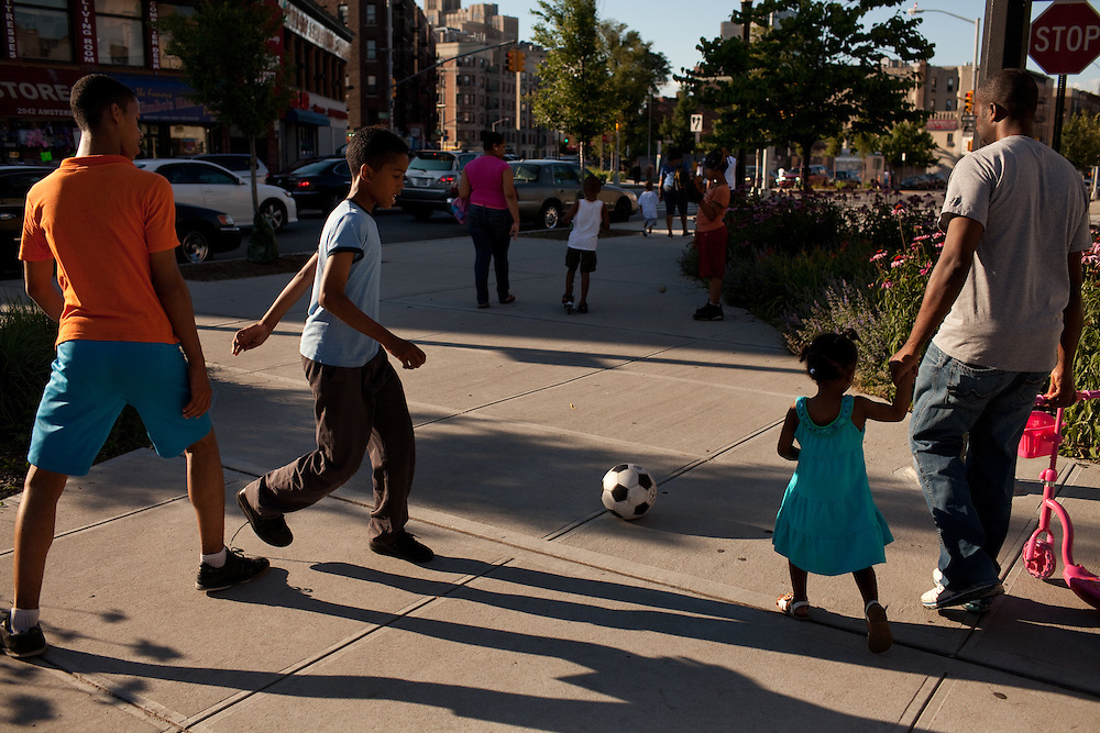 Brothers Christopher Cuello, 14, and Fredery Cuello, 12, play soccer alongside Amsterdam Ave in Sugar Hill on June 23, 2012.