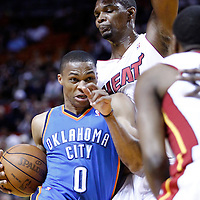 16 March 2011: Oklahoma City Thunder point guard Russell Westbrook (0) drives past Miami Heat power forward Chris Bosh (1) during the Oklahoma City Thunder 96-85 victory over the Miami Heat at the AmericanAirlines Arena, Miami, Florida, USA.