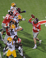 Mississippi quarterback Bo Wallace (14) passes behind his offensive line as LSU rushes at Vaught-Hemingway Stadium in Oxford, Miss. on Saturday, October 19, 2013. (AP Photo/Oxford Eagle, Bruce Newman)