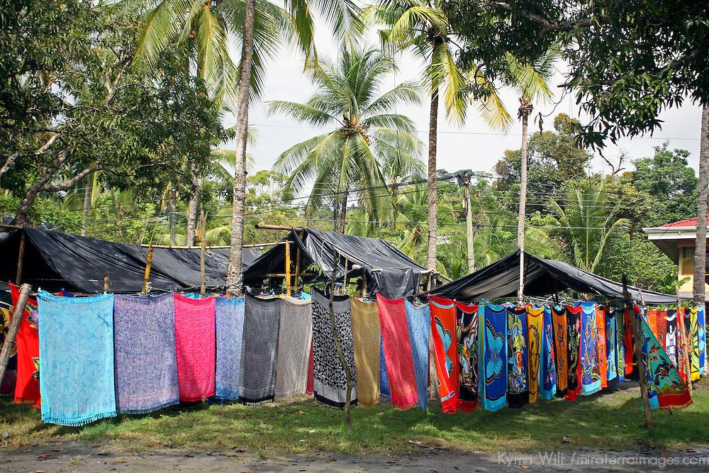 Central America, Costa Rica, Manuel Antonio. Batiks hanging along beach make for colorful souvenirs of Costa Rica.