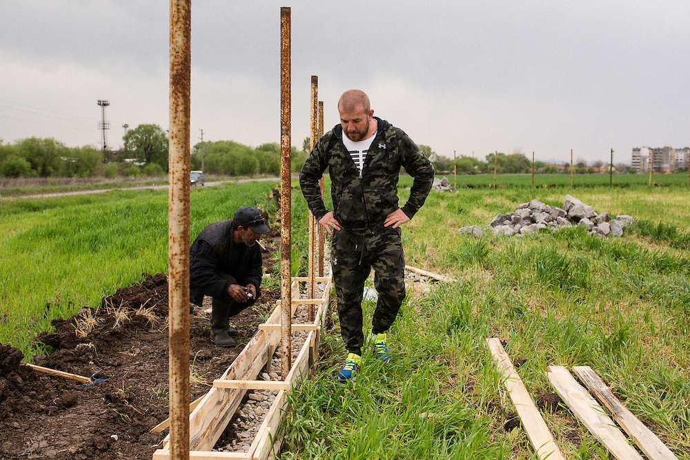 Dinko Valev surveys work on a fence done by his employees at the site of his new junkyard in Yambol, Bulgaria. <br /> <br /> Matt Lutton / Boreal Collective for VICE