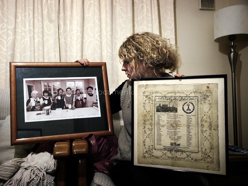 Rachel at her parents home looks at a photograph of some miners wives' taken during the 1984 strike and a memorabilia commemorating the miners who lost their lives in the Cadeby pit explosion. The Cadeby Pit Disaster of 1912 resulted in the death of 91 miners.