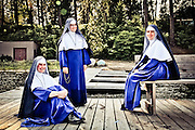 Three Nuns relax on a pier in deer lake, Eastern Washington.