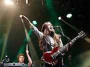 Alana Haim of Haim performs live on the NME/Radio 1 stage during day three of Reading Festival at Richfield Avenue on August 25, 2013 in Reading, England.  (Photo by Simone Joyner)