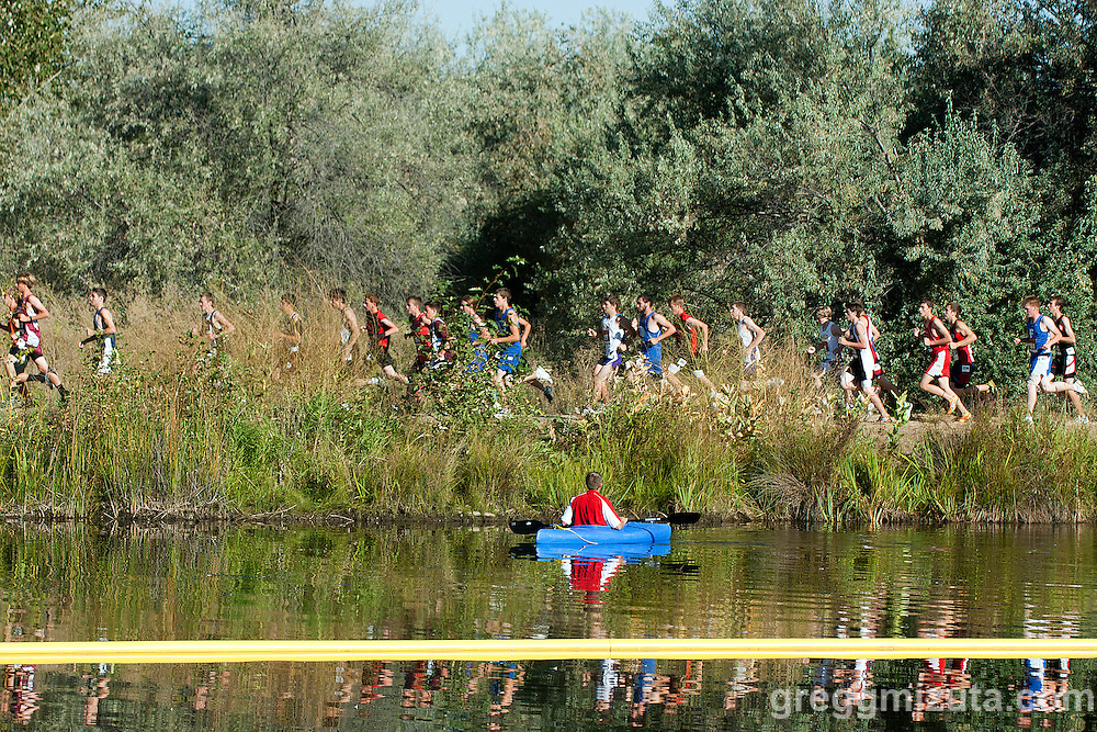 Coaching from a canoe during the Bob Firman Invitational boys D1 race at Eagle Island State Park in Eagle, Idaho on September 24, 2011.