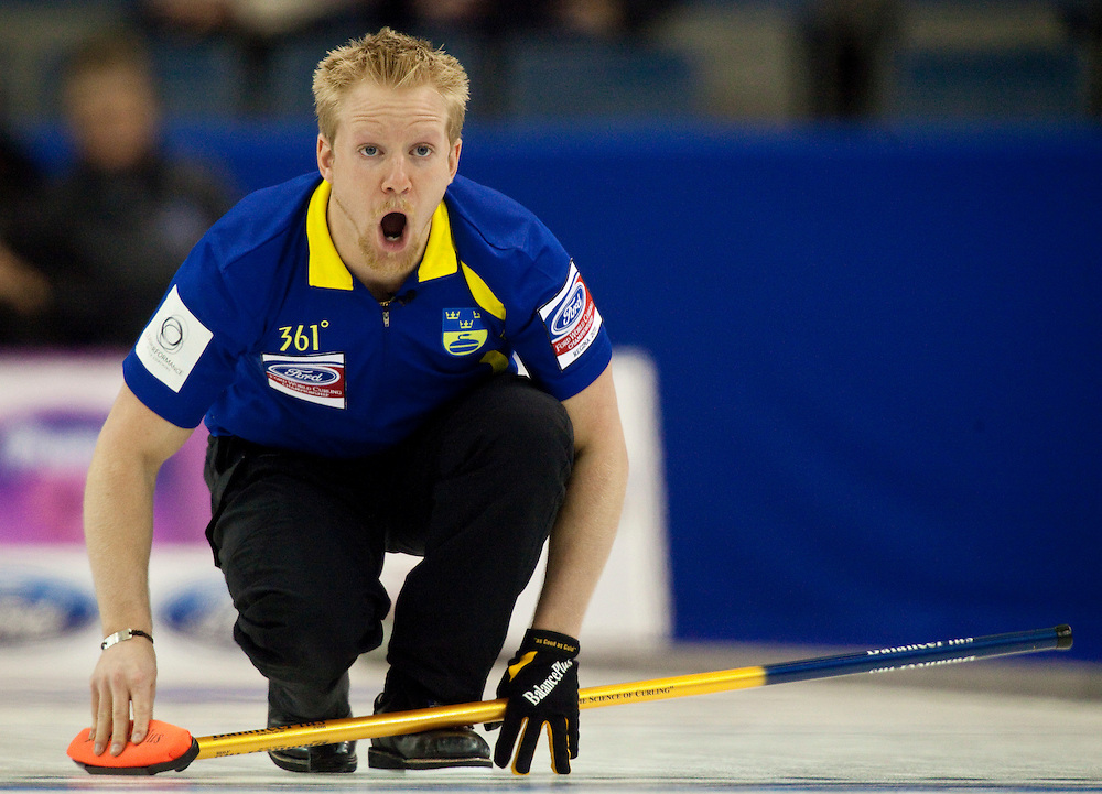 Swedish skip Niklas Edin encourages his sweepers during Sweden's 7-2 loss to Norway in the 3-4 page playoff draw at the Ford World Men's Curling Championships in Regina, Saskatchewan, April 9, 2011.<br /> AFP PHOTO/Geoff Robins