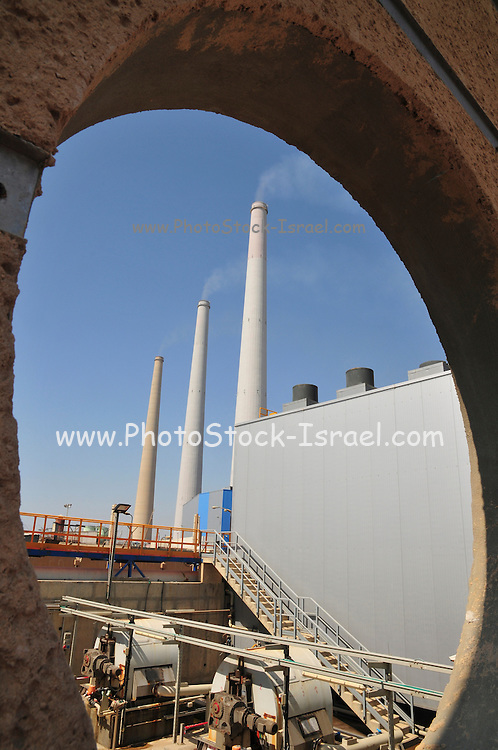 Desalination plant. water pumps the flues of the Hadera power station in the background. This facility turns salt water into drinking water using the Reverse Osmosis Process and will produce 127 million cubic metres of fresh water each year. Photographed in Hadera, Israel.