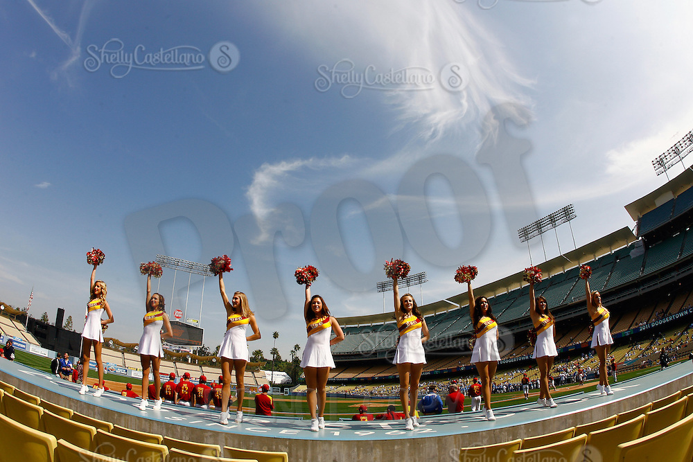 13 March 2011: NCAA Pac-10 college UCLA-USC sports rivalry baseball teams met in a non-conference game at Dodger Stadium as part of the Dodgertown Classic.  USC Trojans defeated the UCLA Bruins 2-0 during an afternoon weekend game inside the MLB stadium.  Song Girl, cheerleaders at the game cheering on the top of the players dugout.