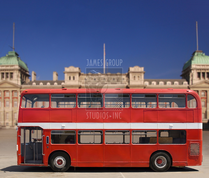 Vintage red British double decker bus in front of Buckingham Palace with clipping path